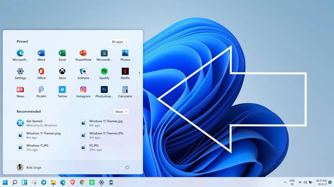 Di chuyển thanh Taskbar qua bên trái trên Windows 11